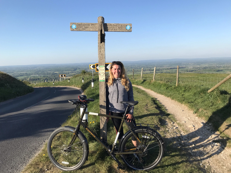 Leaning against the signpost for dear life at the top of Ditchling beacon