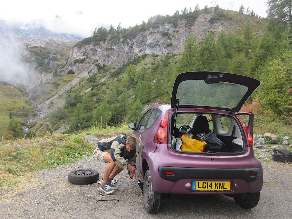 Alex changing a tyre just after the highest point on the Stelvio Pass, Italy, 2020
